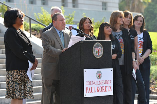 Los Angeles Councilmember Paul Koretz, center, appears at the Stand Up To Cancer Day announcement at Los Angeles City Hall on Tuesday, Sept. 4, 2012. Koretz and the City of Los Angeles held the news c