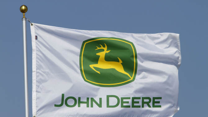 In this Aug. 31, 2011 photo, a flag displaying the John Deere logo flies at the John Deere farming equipment exhibit area during the Farm Progress Show in Decatur, Ill. Deere & Co., the world's largest maker of agricultural equipment, reported a bigger fourth-quarter profit Wednesday, Nov. 21, 2012, as it sold more equipment at higher prices, but results still missed analyst expectations. (AP Photo/Seth Perlman)