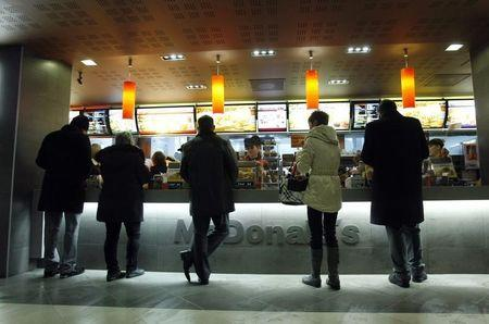 Customers buy food at a McDonald's restaurant in Moscow