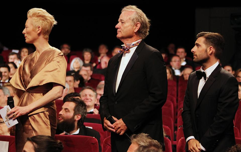 From left, actors Tilda Swinton, Bill Murray and Jason Schwartzman attend the opening ceremony at the 65th international film festival, in Cannes, southern France, Wednesday, May 16, 2012. (AP Photo/Joel Ryan)