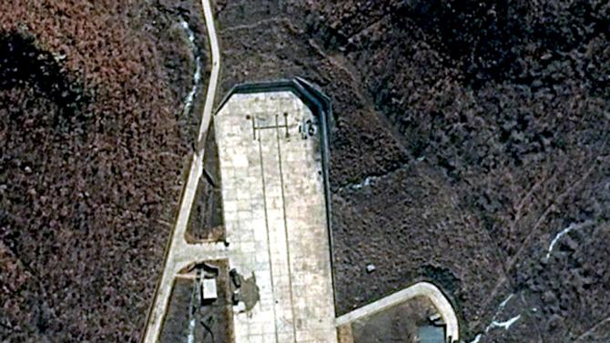 This March 28, 2012 satellite image provided by DigitalGlobe shows North Korea's  Tongchang-ri Launch Facility on the nation's northwest coast. The image appears to show preparations beginning for a long-range rocket launch in North Korea despite international objections. An analysis conducted for the U.S.-Korea Institute at Johns Hopkins School of Advanced International Studies says the image shows trucks and fuel tanks, and work underway on the gantry next to a mobile launch pad. (AP Photo/DigitalGlobe) MANDATORY CREDIT