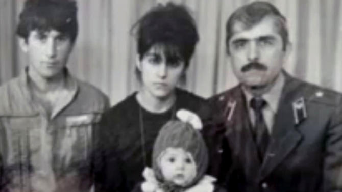 In this image taken from a video, an undated family photo provided by Patimat Suleimanova, the aunt of USA Boston bomb suspects, shows Anzor Tsarnaev left, Zubeidat Tsarnaev holding Tamerlan Tsarnaev and Anzor's brother Mukhammad Tsarnaev. Now known as the angry and grieving mother of the Boston Marathon bombing suspects, Zubeidat Tsarnaev is drawing increased attention after federal officials say Russian authorities intercepted her phone calls, including one in which she vaguely discussed jihad with her elder son. In another, she was recorded talking to someone in southern Russia who is under FBI investigation in an unrelated case, U.S. officials said. (AP Photo/Patimat Suleimanova)