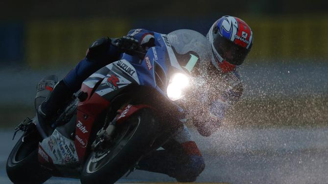 Suzuki rider Philippe of France competes during the 37th Le Mans 24 Hours motorcycling endurance race in Le Mans