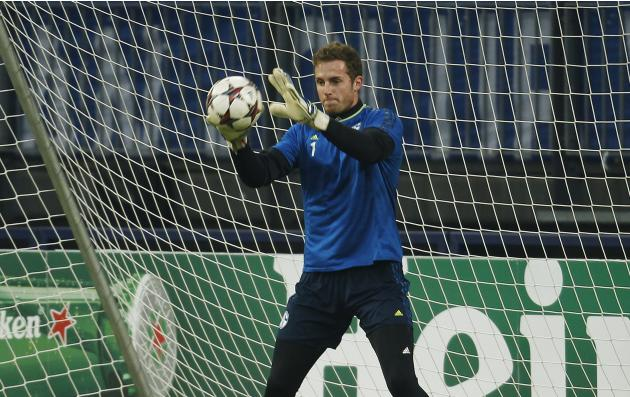 Schalke 04's goalkeeper Faehrmann catches a ball during a training session in Gelsenkirchen