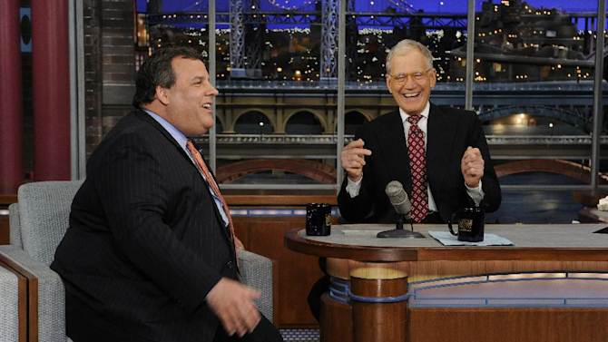 """In this photo released by CBS Broadcasting, New Jersey Gov. Chris Christie, left, and late night host David Letterman, right, react with laughter during the Governor's first visit to CBS' """"Late Show with David Letterman,"""" on Monday, Feb. 4, 2013 in New York. (AP Photo/CBS Broadcasting, Jeffrey Neira)"""