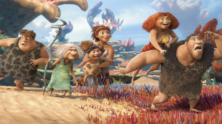 "This film publicity image released by DreamWorks Animation shows, from left, Thunk, voiced by Clark Duke, Gran, voiced by Cloris Leachman, Ugga, voiced by Catherine Keener, who is holding Sandy, voiced by Randy Thom, Eep, voiced by Emma Stone and Grug, voiced by Nicolas Cage, in a scene from ""The Croods."" (AP Photo/DreamWorks Animation)"
