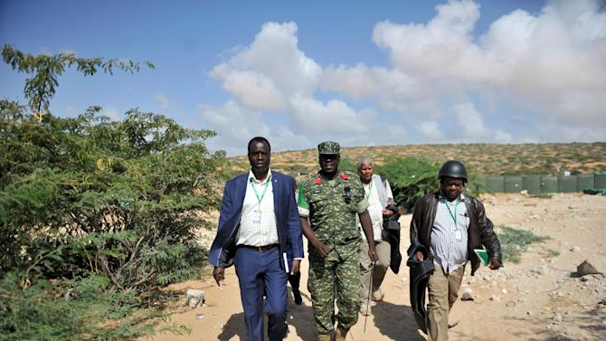 Officials from the African Union Commission, led by Maj. Gen. Francis Okello from the Peace Support Operations Division, accompanied by AMISOM officials, arrive in Marka