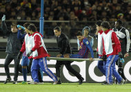 Spain's FC Barcelona forward David Villa on a stretcher is taken away from the pitch after he was injured during their semifinal match against Qatar's Al-Sadd Sports Club at the Club World Cup soccer tournament in Yokohama, near Tokyo, Thursday, Dec. 15, 2011. (AP Photo/Koji Sasahara)