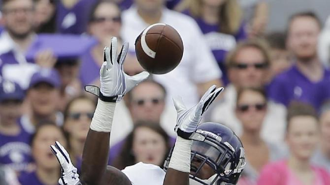 Western Illinois wide receiver Lance Lenoir Jr. (7) catches the ball against Northwestern cornerback Matthew Harris (27) during the first half of an NCAA college football game in Evanston, Ill., Saturday, Sept. 20, 2014