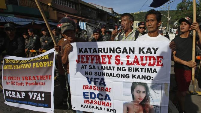 Demonstrators protest against U.S. Marine Joseph Pemberton outside a court in Olongapo city