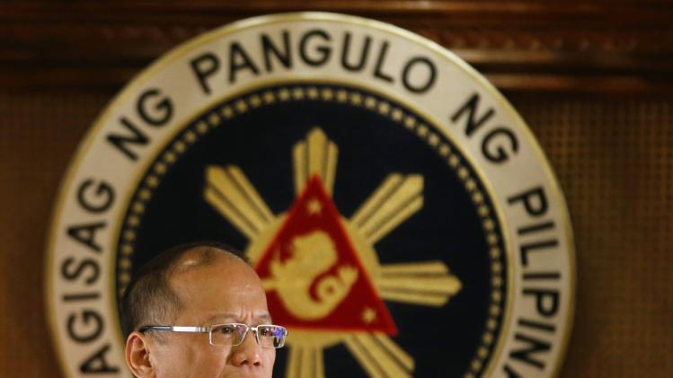 Philippine President Aquino addresses the nation in a live broadcast in Manila