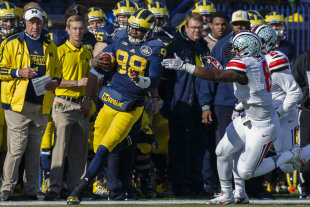 Michigan QB Devin Gardner (98) finished with 451 passing yards and five total TDs. (USA Today)