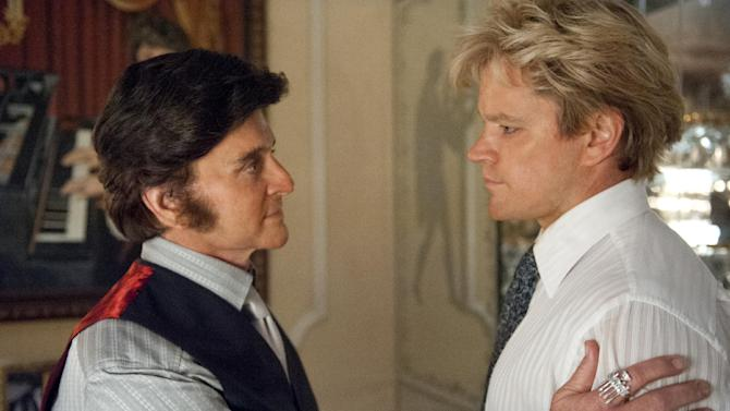 """This film image released by HBO shows Michael Douglas, left, as Liberace, and Matt Damon, as Scott Thorson in a scene from """"Behind the Candelabra."""" The Nielsen company said the 2.4 million people who tuned in to the movie's premiere over the holiday weekend represented the network's biggest audience for one of its original movies since """"Something the Lord Made"""" in 2004. (AP Photo/HBO, Claudette Barius)"""
