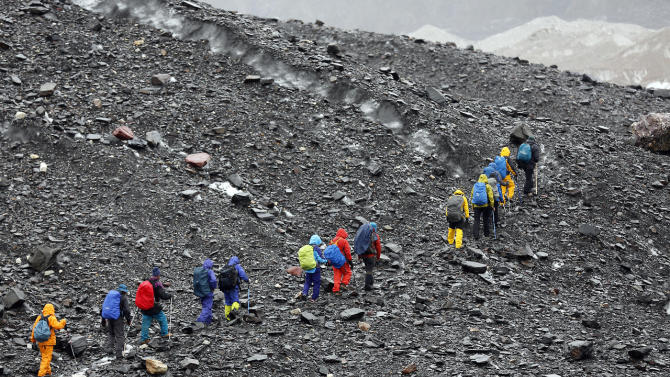 Trekkers climb the Baltoro glacier in the Karakoram mountain range in Pakistan September 3, 2014. (REUTERS/Wolfgang Rattay)