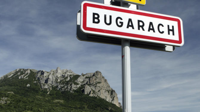 """This June 24, 2011 photo shows the Bugarach mountain peak in southern France. From Russia to California, thousands are preparing for the fateful day, when many believe a 5,125-year cycle known as the Long Count in the Mayan calendar supposedly comes to an end.  The Internet has helped feed the frenzy, spreading rumors that a mountain in the French Pyrenees is hiding an alien spaceship that will be the sole escape from the destruction.  French authorities are blocking access to Bugarach peak from Dec. 19-23 except for the village's 200 residents """"who want to live in peace,"""" the local prefect said in a news release. (AP Photo)"""