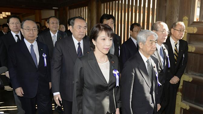 A group of Japanese lawmakers visit the Yasukuni Shrine in Tokyo during an annual spring festival on Tuesday, April 23, 2013. Marking the spring festival, nearly 170 lawmakers paid homage to the controversial war shrine. Policy Chief of the Liberal Democratic Party' Sanae Takaichi, front left, and a member of Japan Restoration Party Takeo Hiramu, third right in the second row, were among the group. (AP Photo/Kyodo News) JAPAN OUT, MANDATORY CREDIT, NO LICENSING IN CHINA, HONG KONG, JAPAN, SOUTH KOREA AND FRANCE