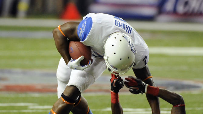 Boise State running back D.J. Harper (7) is brought down by the face mask by Georgia cornerback Branden Smith (1) in the second half of their NCAA college football game on Saturday, Sept. 3, 2011 at the Georgia Dome in Atlanta. Smith was called for the penalty on the play.  (AP Photo/David Tulis)