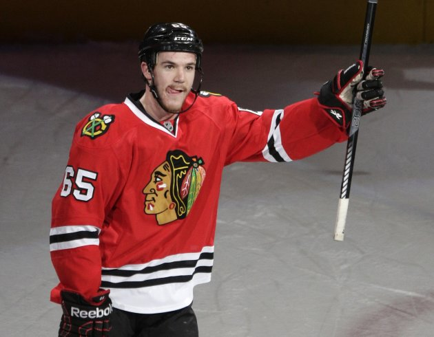 Chicago Blackhawks center Shaw waves to fans after being named first star of the game with two goals against the Detroit Red Wings following Game 5 of their NHL Western Conference semifinal playoff ho