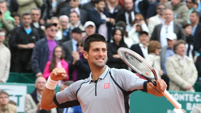 Novak Djokovic of Serbia reacts after defeating Fabio Fognini of Italy in their semifinal match of the Monte Carlo Tennis Masters tournament in Monaco, Saturday, April 20, 2013. (AP Photo/Claude Paris)