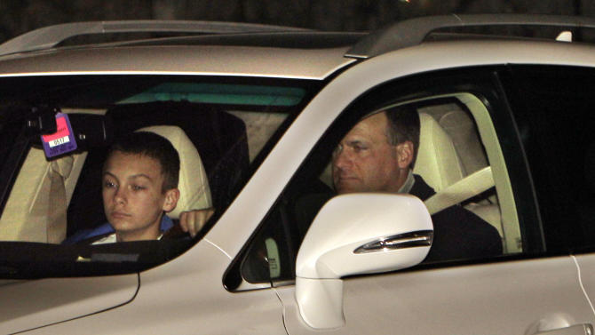 Rich Rodriguez and his son, Rhett, drive away from Schembechler Hall in Ann Arbor, Mich., Wednesday, Jan. 5, 2011. Rodriguez was fired earlier in the day as Michigan's head football coach after three seasons. (AP Photo/Carlos Osorio)