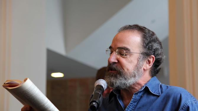 """This Oct. 4, 2012, photo shows actor Mandy Patinkin reading a line from Shakespeare's """"The Tempest"""" during a celebration to help rededicate The Public Theater's new four-year, $40 million face-lift in downtown New York. (AP Photo/Mark Kennedy)"""