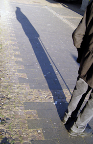 man in shadow