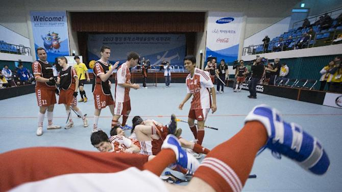 IMAGE DISTRIBUTED FOR SPECIAL OLYMPICS - The Swiss team celebrate their victory after the final match between Austria and Switzerland at the floorball event of the 2013 PyeongChang Special Olympics World Winter Games in Gangneung, S. Korea on the third day of the competition, Thursday, Jan. 31, 2013. (Manchul Kim/AP Images for Special Olympics)