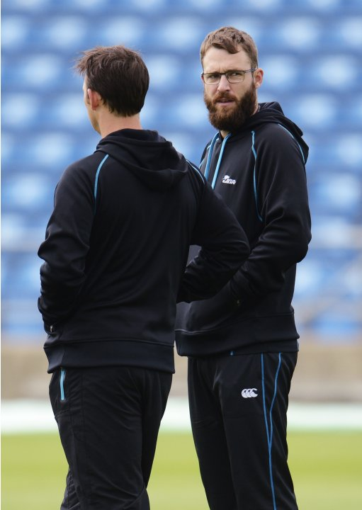 New Zealand's Vettori talks to bowling coach Bond during a training session before the second test cricket match against England in Leeds
