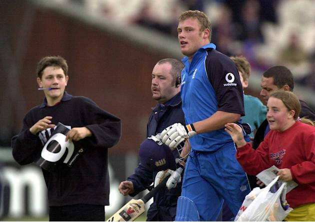13 Jul 2000:  Andrew Flintoff of England is mobbed by kids after England Won the Natwest Triangular tournament England v Zimbabwe One Day International at Old Trafford, Manchester. Mandatory Credit: T