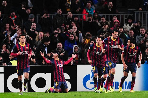 Barcelona's Neymar (C) celebrates scoring a goal during their UEFA Champions League Group H match against Celtic, at the Camp Nou stadium in Barcelona, on December 11, 2013