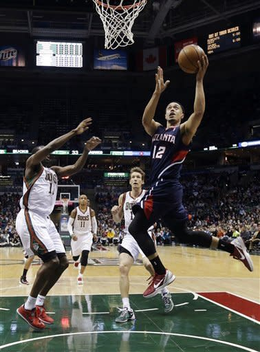 Horford helps Hawks beat Bucks 104-99