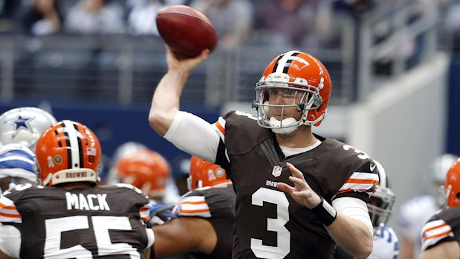 Cleveland Browns' Brandon Weeden (3) passes as Alex Mack (55) works against pressure from the Dallas Cowboys defense in the first half of an NFL football game on Sunday, Nov. 18, 2012, in Arlington, Texas. (AP Photo/Sharon Ellman)