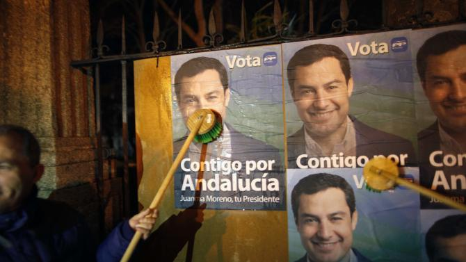 Members of PP put up election posters of PP candidate for the region's elections Moreno Bonilla at the start of his electoral campaign in Ronda