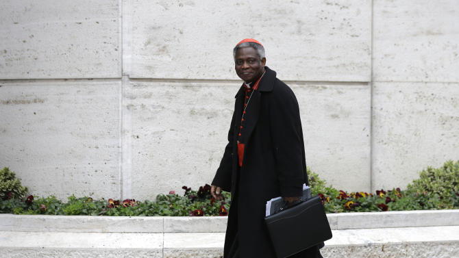 Nigerian Cardinal Peter Kodwo Appiah Turkson arrives for a meeting, at the Vatican, Wednesday, March 6, 2013. Cardinals from around the world have gathered inside the Vatican for their first round of meetings before the conclave to elect the next pope, amid scandals inside and out of the Vatican and the continued reverberations of Benedict XVI's decision to retire. (AP Photo/Alessandra Tarantino)