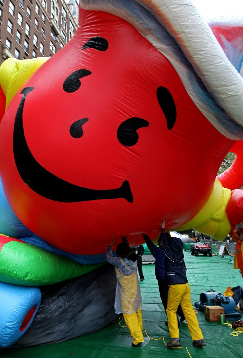 Technicians tip up the Kool-Aid Man balloon while it is inflated for the 85th annual Macy's Thanksgiving Day Parade Wednesday, Nov. 23, 2011 in preparation for Thursday's parade in New York. (AP Photo/Craig Ruttle)