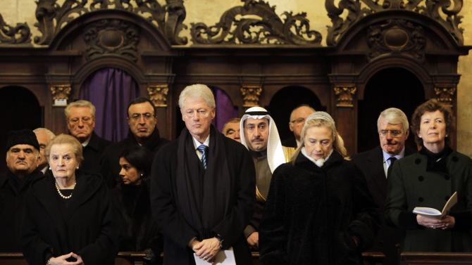 """Former US Secretary of State Madeleine Albright, former US President Bill Clinton and US Secretary of State Hillary R. Clinton, from left, attend the state funeral of former Czech President Vaclav Havel in the St. Vitus Cathedral in Prague, Friday, Dec. 23, 2011. Havel was the leader of the peaceful anti-communist """"Velvet Revolution."""" He died Sunday, Dec. 18, at age 75. (AP Photo/Markus Schreiber)"""
