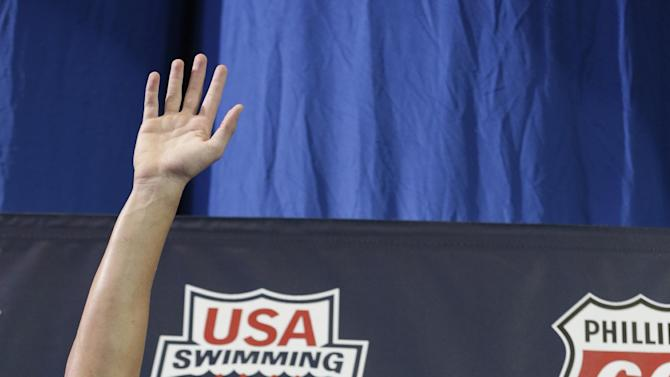 Ryan Lochte waves to the crowd after winning the men's 200-meter freestyle in 1 minute, 45.97 seconds during the U.S. National Championships swimming meet Wednesday, June 26, 2013, in Indianapolis. (AP Photo/Darron Cummings)