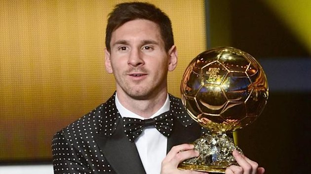 FIFA Ballon d'Or award winner Barcelona's Argentinian forward Lionel Messi poses with his trophy after the FIFA Ballon d'Or awards ceremony at the Kongresshaus in Zurich