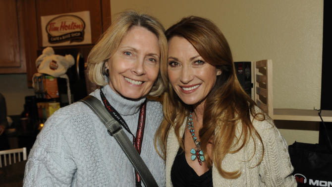 Cynthia Sexton, EVP Branding and Licensing at Island Def Jam Music Group, left, and actress Jane Seymour pose at the Fender Music lodge during the Sundance Film Festival on Saturday, Jan. 19, 2013, in Park City, Utah. (Photo by Jack Dempsey/Invision for Fender/AP Images)