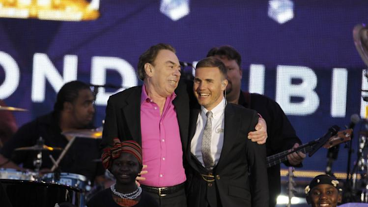 Sir Andrew Lloyd Webber and Gary Barlow onstage at the Queen's Jubilee Concert in front of Buckingham Palace, London, Monday, June 4, 2012. The concert is a part of four days of celebrations to mark the 60 year reign of Britain's Queen Elizabeth II. (AP Photo/Joel Ryan)