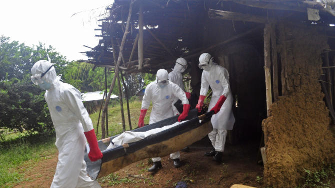 Ebola health care workers carry the body of a middle aged man that they suspected of dying from the Ebola, on the outskirts of Monrovia, Liberia, Saturday, Nov. 8, 2014. Dr. Robert Fuller didn't hesitate to go to Indonesia to treat survivors of the 2004 tsunami, to Haiti to help after the 2010 earthquake or to the Philippines after a devastating typhoon last year. But he's given up on going to West Africa to care for Ebola patients this winter.  (AP Photo/ Abbas Dulleh)