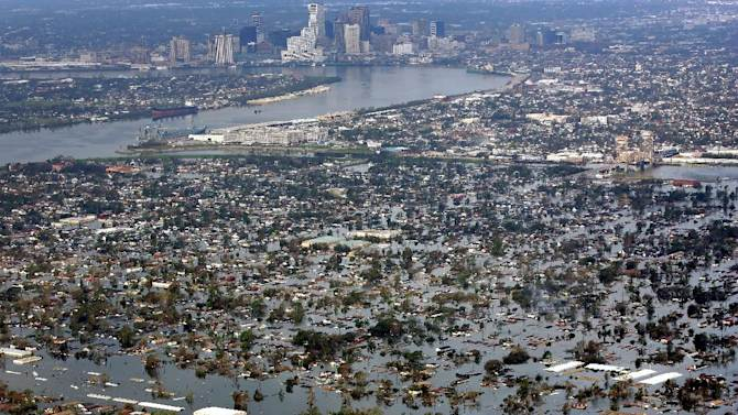 FILE - This Aug. 30, 2005 file photo shows floodwaters from Hurricane Katrina coverig a portion of New Orleans. A new psychology study shows that people are wrongly less prone to flee from hurricanes with feminine names. Yet the study finds female named storms have been deadlier in the United States than their macho sounding counterparts. Katrina and Sandy are the two deadliest storms to make landfall in the U.S. since names went co-ed in 1979. The study, which didn't involve experts in meteorology or disaster science, is published Monday in the Proceedings of the National Academy of Sciences. (AP Photo/David J. Phillip, File)