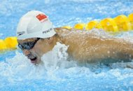 China&#39;s Wu Peng at the FINA World Championships in Shanghai in July 2011. Wu used an impressive finishing kick to beat Michael Phelps in the 200-meter butterfly at the Charlotte UltraSwim Grand Prix meet