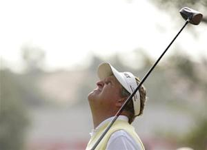 Montgomerie of Scotland looks up while playing on the 10th hole during the Champions golf tournament in Shanghai