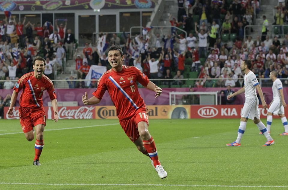 Russia's Alan Dzagoyev, second left,  and Konstantin Zyryanov celebrate after scoring against Czech Republic during the Euro 2012 Group A soccer match between Russia and Czech Republic, in Wroclaw, Poland, Friday, June 8, 2012.  (AP Photo/Sergey Ponomarev)