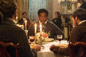 """This film publicity image released by Fox Searchlight shows Chiwetel Ejiofor as Solomon Northup in a scene from """"12 Years A Slave."""" The New York Times has printed a correction for misspelling 161 years ago the name of a free black man who was sold into slavery and whose memoirs were turned into the Oscar-winning movie """"12 Years a Slave."""" (AP Photo/Fox Searchlight Films, Jaap Buitendijk)"""