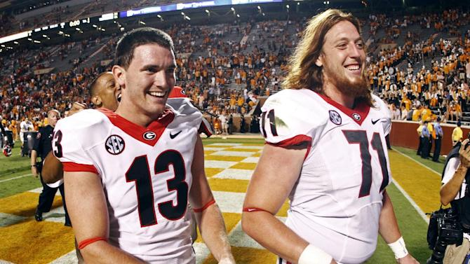 Georgia's Marshall Morgan (13) walks off the field with John Theus (71) after defeating Tennessee 34-31 in overtime of an NCAA college football game on Saturday, Oct. 5, 2013, in Knoxville, Tenn