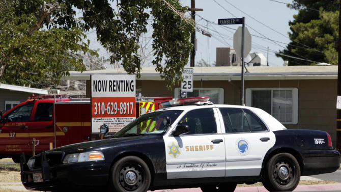 A Los Angeles County Sheriff's patrol car sits in a Palmdale, Calif., neighborhood Friday Aug. 19, 2011. The Los Angeles County Sheriff's Department is the focus of a federal probe over allegations that deputies discriminated against blacks and Hispanics in two high desert cities, Palmdale and Lancaster, especially those in subsidized housing, officials announced Friday.   (AP Photo/Nick Ut)