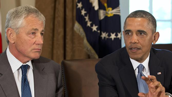 Defense Secretary Chuck Hagel listens as President Barack Obama speaks during a meeting to discuss sexual assault in the military in the Cabinet Room of the White House in Washington, Thursday, May 16, 2013. (AP Photo/Jacquelyn Martin)
