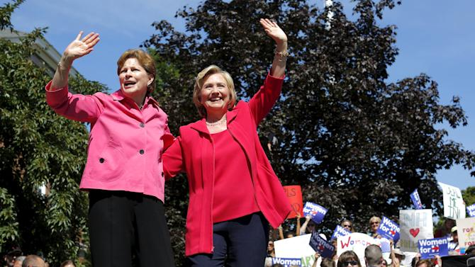 U.S. Democratic presidential candidate Hillary Clinton and U.S. Senator Jeanne Shaheen stand together at a campaign rally in Portsmouth